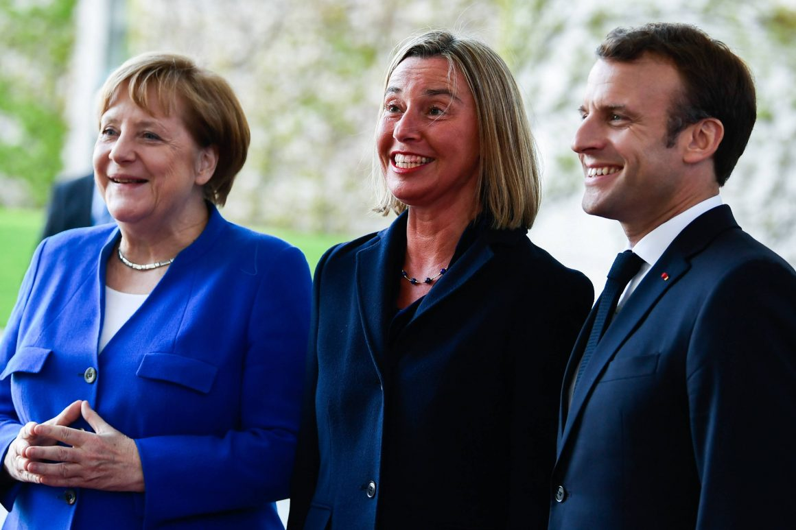 GERMAN CHANCELLOR ANGELA MERKEL; EUROPEAN UNION HIGH REPRESENTATIVE FOR FOREIGN AFFAIRS AND SECURITY POLICY FEDERICA MOGHERINI; AND FRENCH PRESIDENT EMMANUEL MACRON POSE FOR PHOTOGRAPHERS DURING THE ARRIVALS FOR A 'WESTERN BALKANS CONFERENCE' AT THE CHANCELLERY IN BERLIN, GERMANY, 29 APRIL 2019. © FILIP SINGER (PAP/EPA)